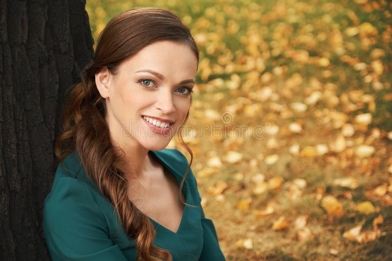 Happy smiling woman in the park stock photos