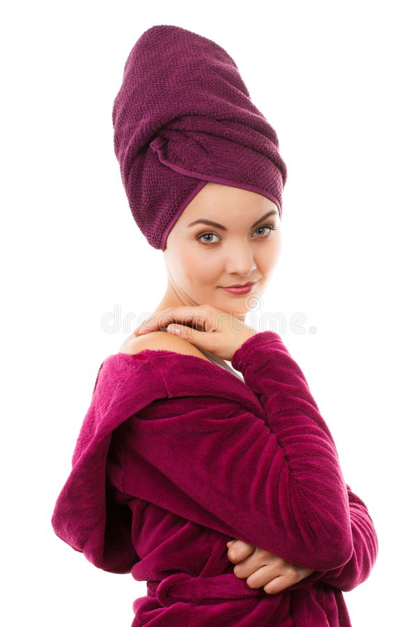 Happy smiling woman in purple bathrobe, enjoying freshness and wellbeing stock images