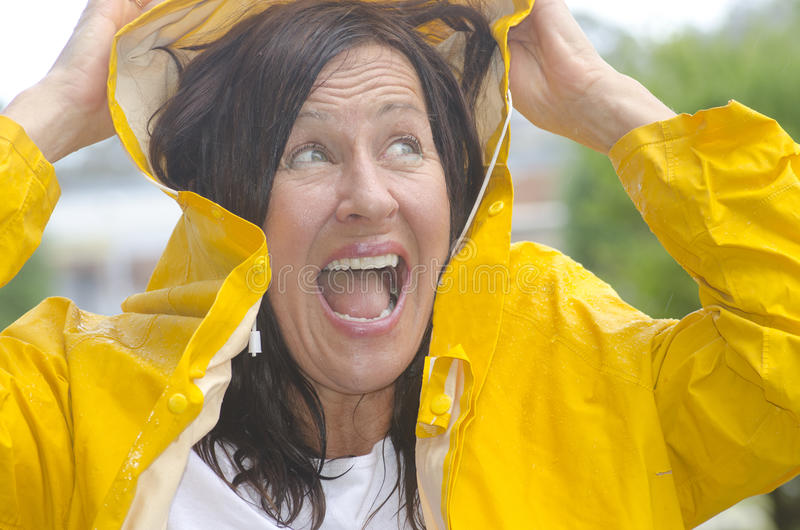 Happy smiling woman in rain royalty free stock photography