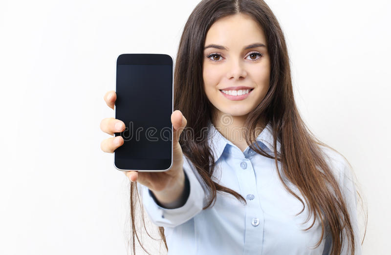 happy smiling woman showing mobile phone isolated in white background stock photo