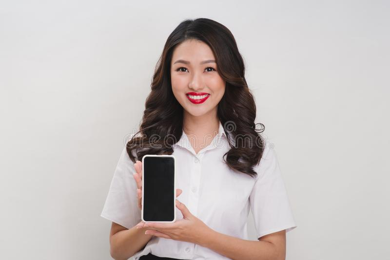 happy smiling woman showing mobile phone isolated in white background stock images