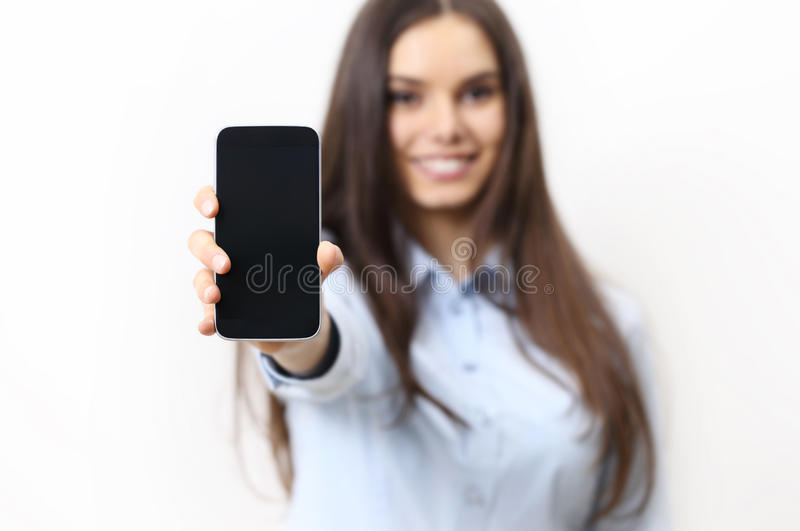 Happy smiling woman showing mobile phone isolated on white royalty free stock photos