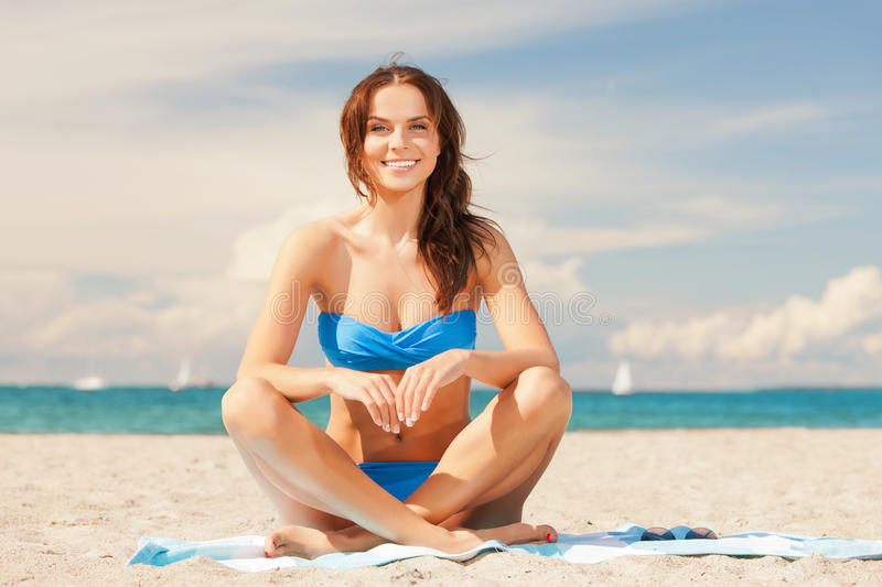 Download Happy Smiling Woman Sitting On A Towel Stock Image - Image of bikini, blue: 39515609