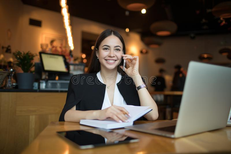Happy smiling woman successful business worker having mobile phone conversation stock photography