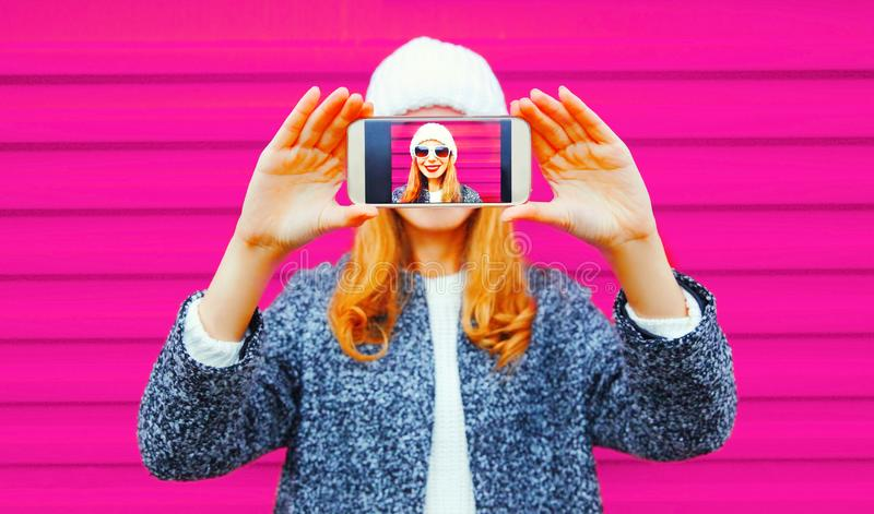 Happy smiling woman taking selfie close-up by smartphone having royalty free stock photography
