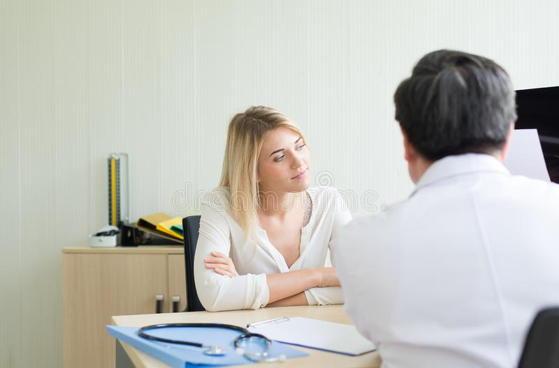 Happy and smiling woman talking to doctor psychiatrist in hospital,Discuss issue and find solutions to mental health problems. Happy and smiling women talking to stock images
