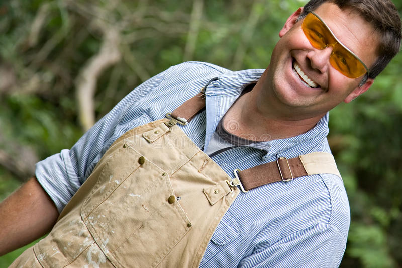 Download Happy smiling worker man stock image. Image of coveralls - 10181825