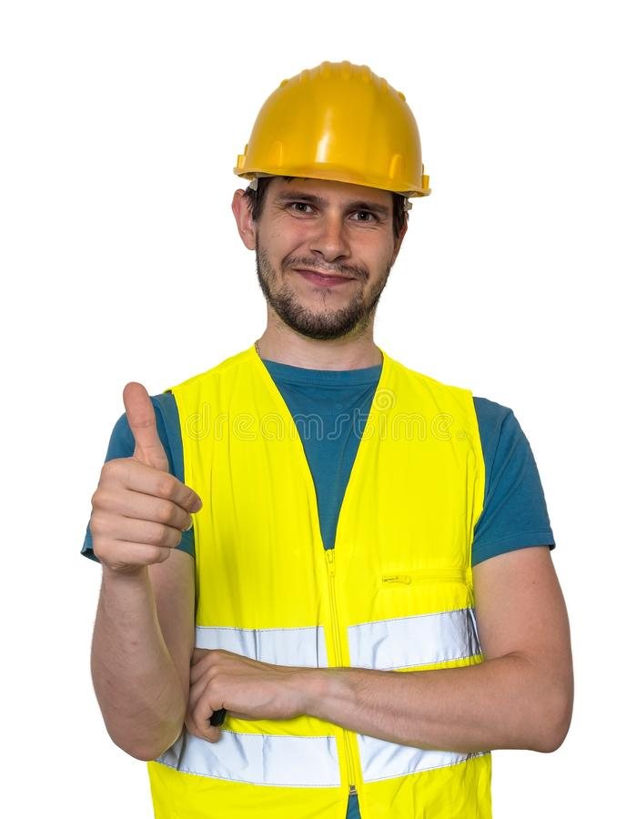Happy smiling worker is showing thumbs up gesture. Isolated on white background stock images