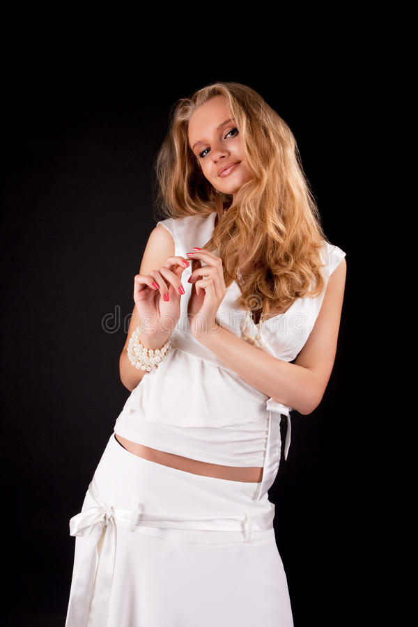 Happy smiling young blonde girl in white dress royalty free stock photo