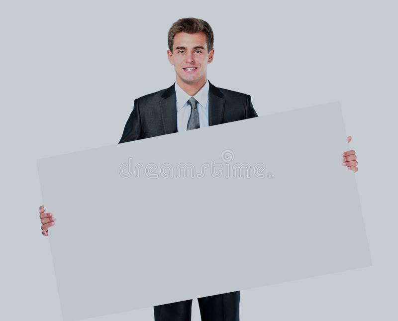 Happy smiling young business man showing blank signboard. Happy smiling young business man showing blank signboard royalty free stock photography