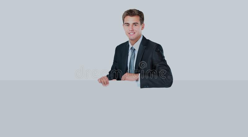 Happy smiling young business man showing blank signboard. Happy smiling young business man showing blank signboard royalty free stock image