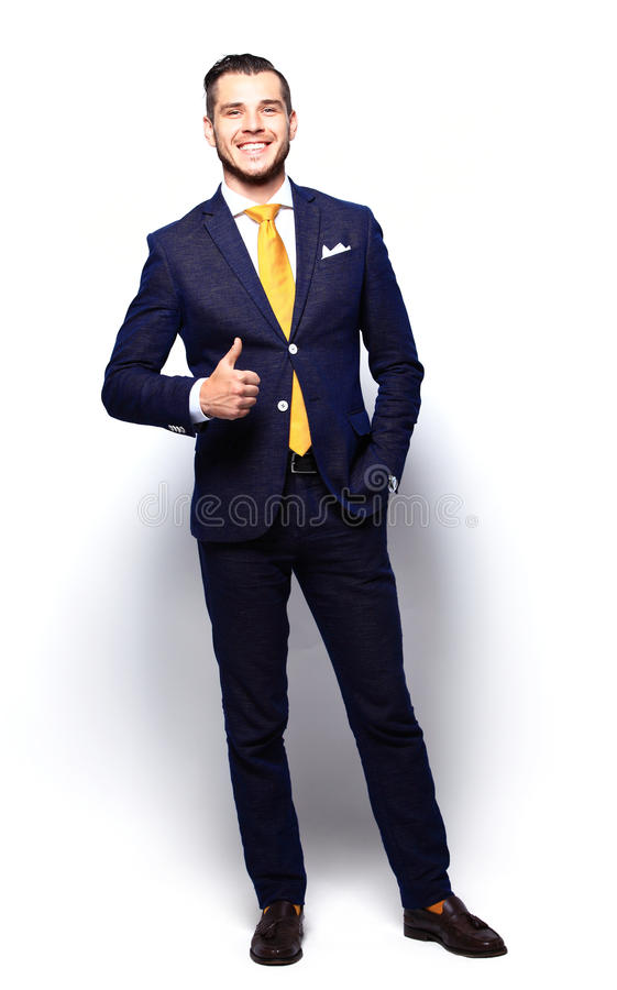 Happy smiling young business man with thumbs up gesture royalty free stock images