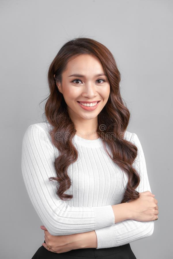 Happy smiling young businesswoman, on grey background. Blank copyspace area for advertise text or slogan royalty free stock photos