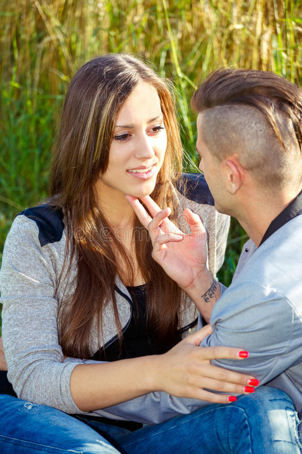 Happy smiling young couple outdoor. valentine concept royalty free stock photography
