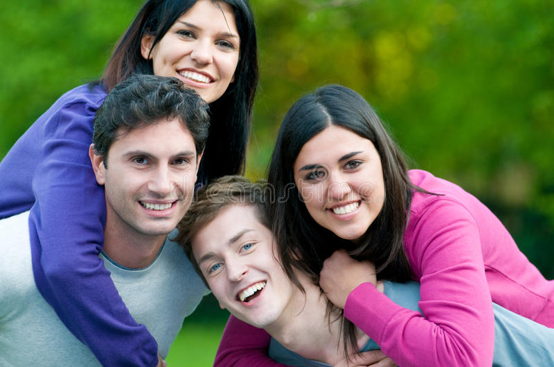 Happy smiling young couples together stock photo