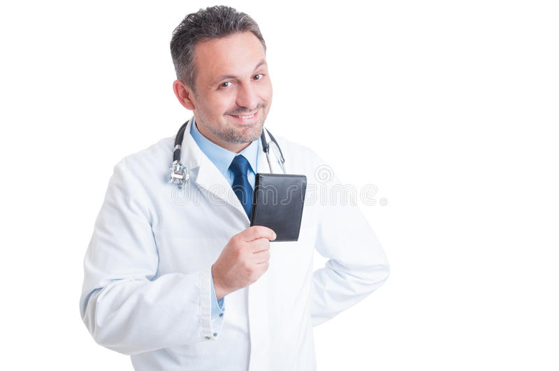 Happy smiling young doctor or medic holding wallet royalty free stock image