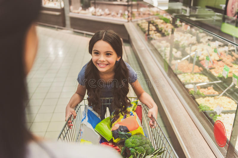 Happy smiling young lady doing shopping stock photography