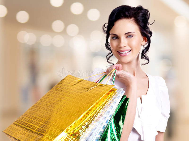 Download Happy Smiling Young Woman With Color Bags. Stock Photo - Image: 38319560