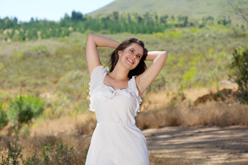 Happy smiling young woman enjoying nature stock photo