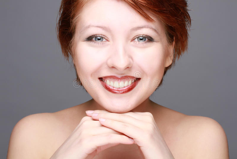 Happy smiling young woman face stock image