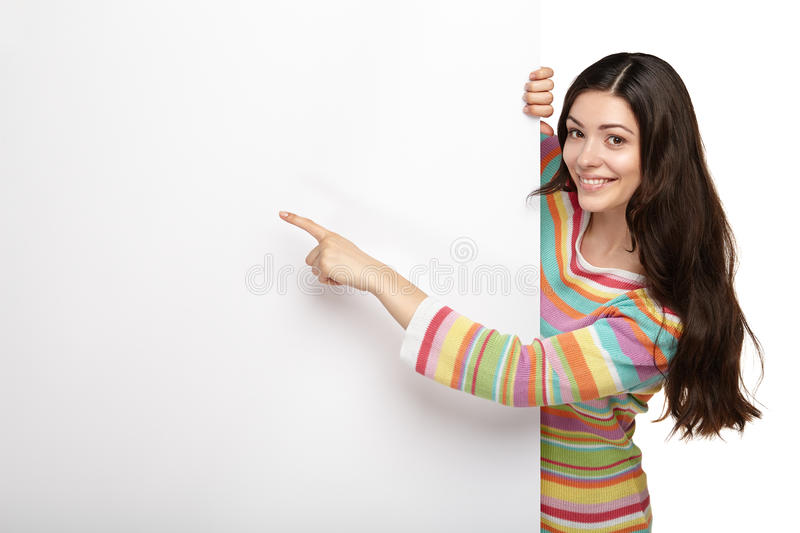 Happy smiling young woman showing blank signboard. Happy smiling beautiful young woman showing blank signboard or copyspace for slogan or text, isolated over royalty free stock image