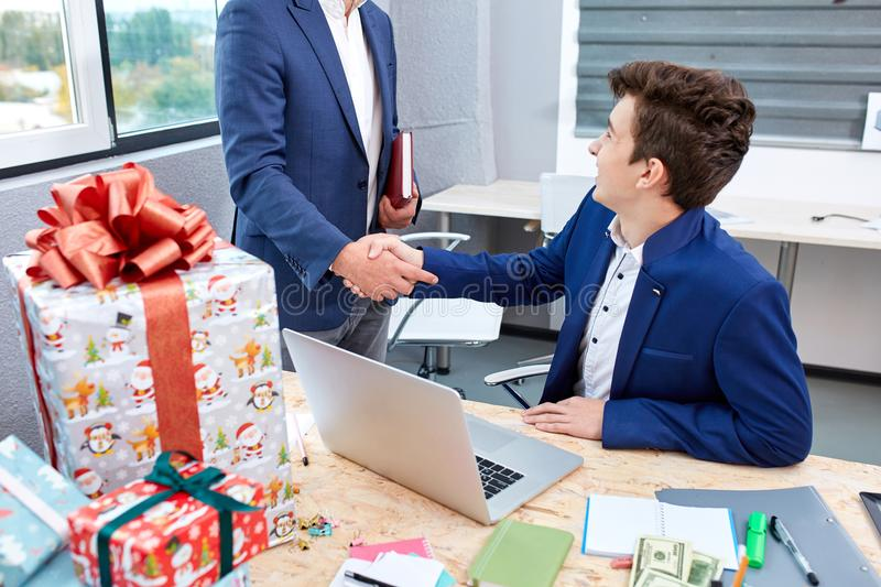 Two businessmen giving warm welcome, trust, teamwork, agreement to each other. Business concept. royalty free stock images
