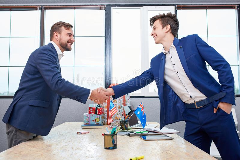 Two businessmen giving warm welcome, trust, teamwork, agreement to each other. Business concept. stock image