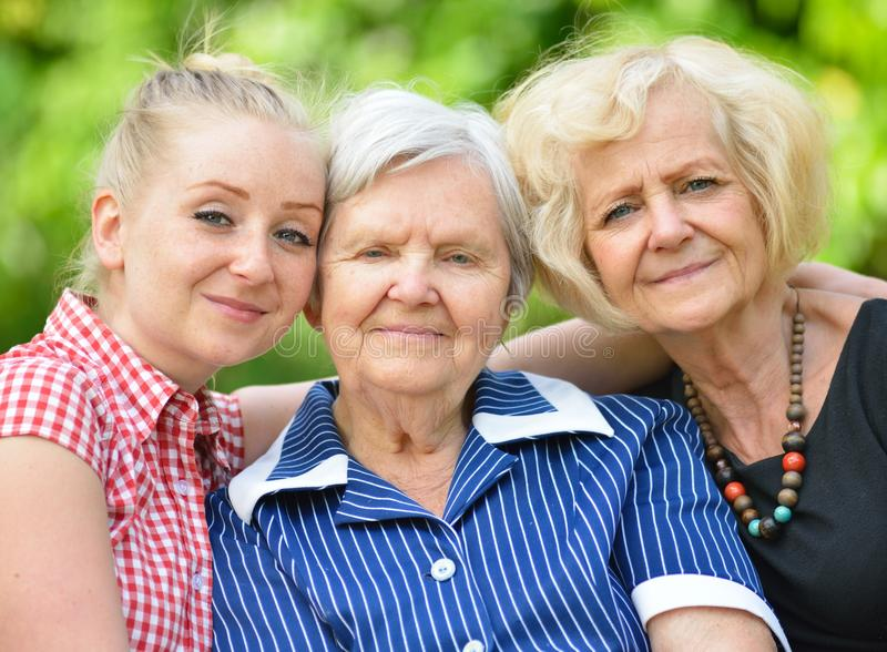 Happy and smilling family. Three generations of women stock image