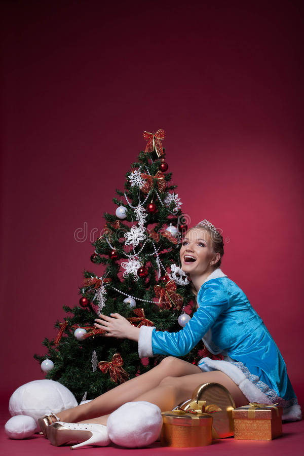 Download Happy Snow Maiden Posing With Christmas Tree Stock Photo - Image: 33299552