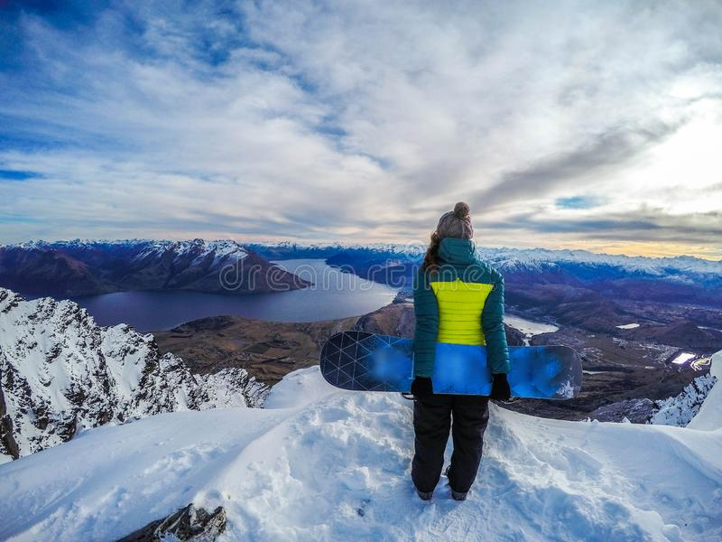 Happy snowboarding girl, Remarkables, New Zealand stock images
