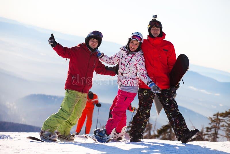 Happy snowboarding team stock image