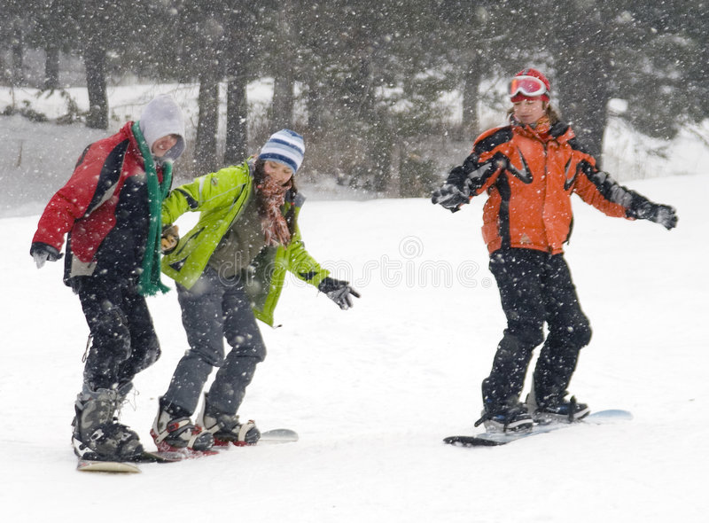 Happy snowboarding teens team royalty free stock image