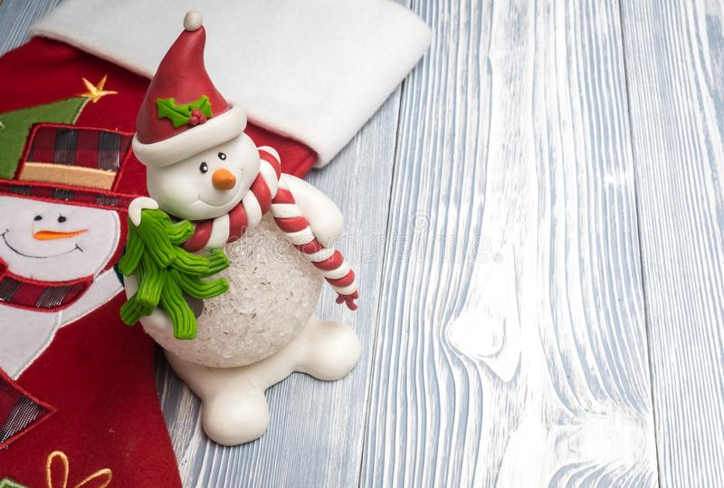 Happy snowman with red sock royalty free stock photos