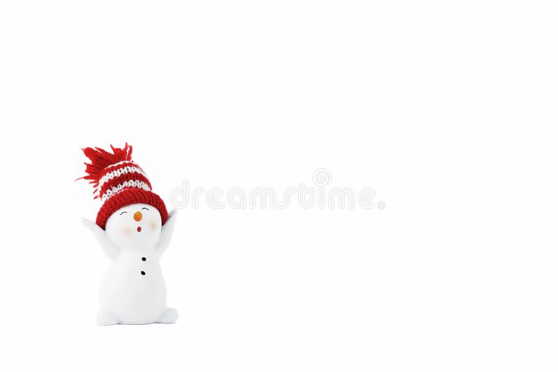 Happy snowman standing isolated on white background. Merry christmas and happy new year greeting card. Funny snowman in hat on stock images