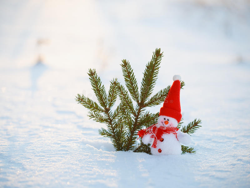 Happy snowman standing in winter christmas landscape.Snow background stock photography
