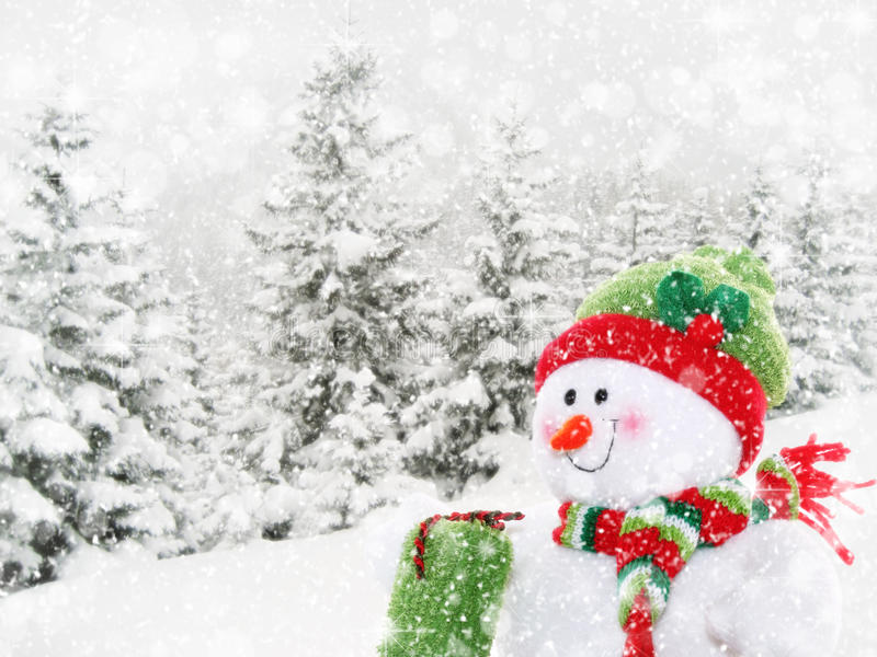 Happy snowman in winter landscape stock photography
