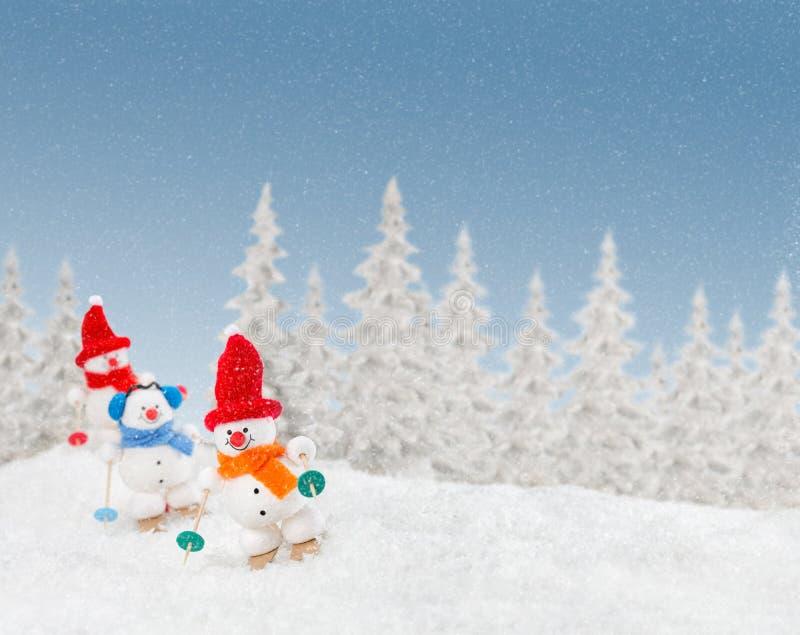 Happy snowmen out skiing. royalty free stock photos