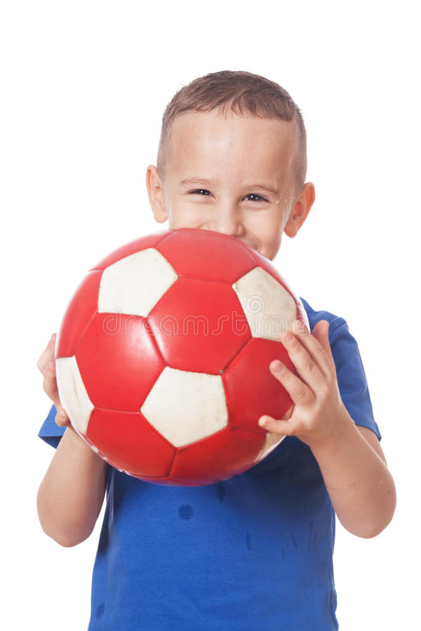 Happy soccer player. Happy adorable soccer player on isolated white royalty free stock image
