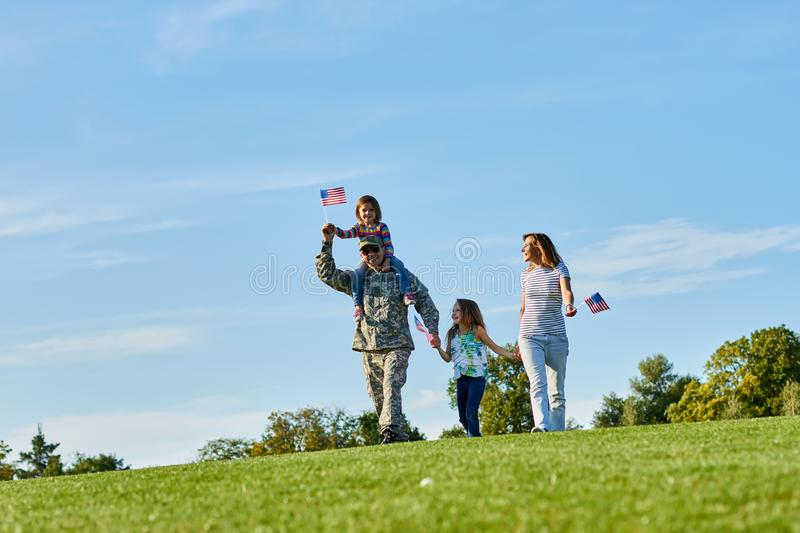 Happy soldier with family outdoors. stock image
