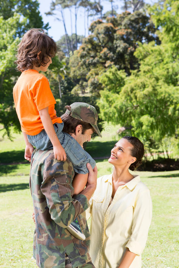 Happy soldier reunited with family royalty free stock images