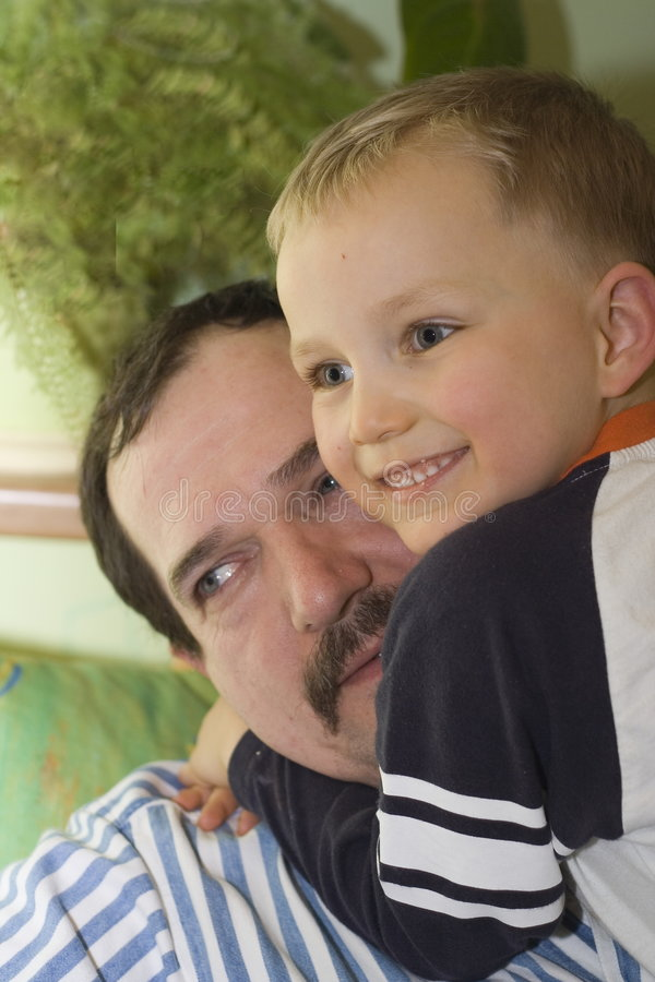 Happy son with father stock photos