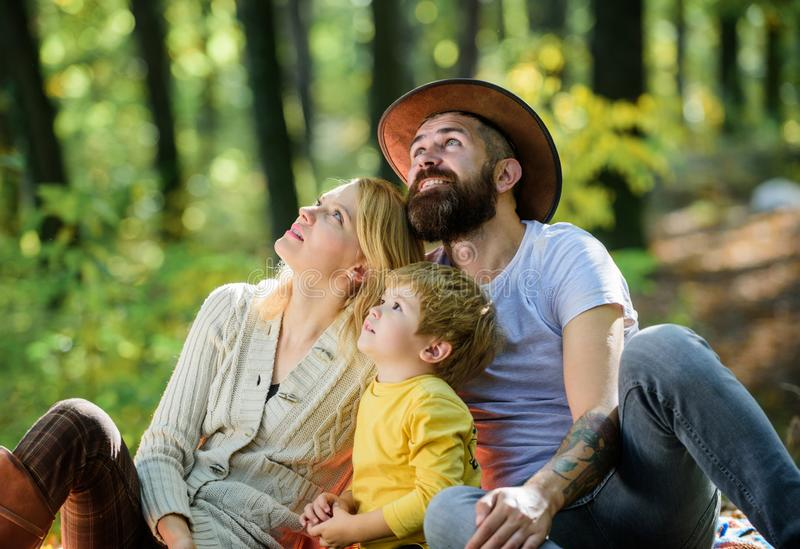 Happy son with parents relax in autumn forest. Mother, cowboy father love their little boy child. Spring mood. Happy. Family day. Sunny weather. Healthy food stock photos