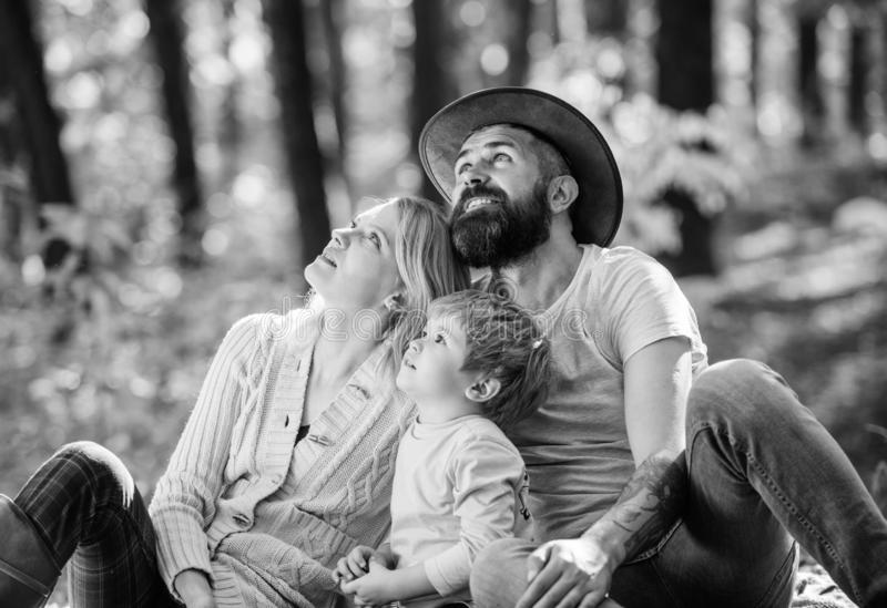 Happy son with parents relax in autumn forest. Mother, cowboy father love their little boy child. Spring mood. Happy. Family day. Sunny weather. Healthy food royalty free stock photo