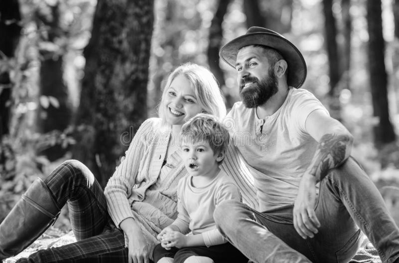 Happy son with parents relax in autumn forest. Sunny weather. Healthy food. Mother, cowboy father love their little boy. Child. Spring mood. Happy family day royalty free stock photography