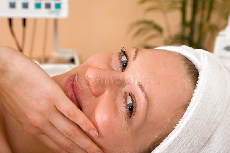 Happy at spa. Beautiful young woman happy at the spa center stock photography