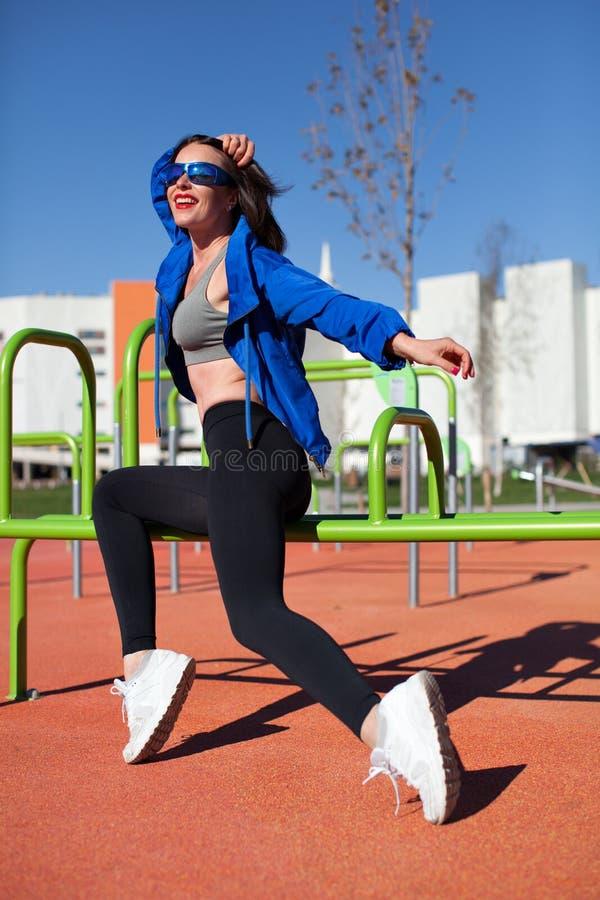 Happy sport woman dancing outdoors stock photos