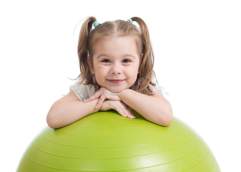 Happy sportive kid playing with fitness ball isolated on white background. Happy sportive child playing with fitness ball isolated on white background stock image