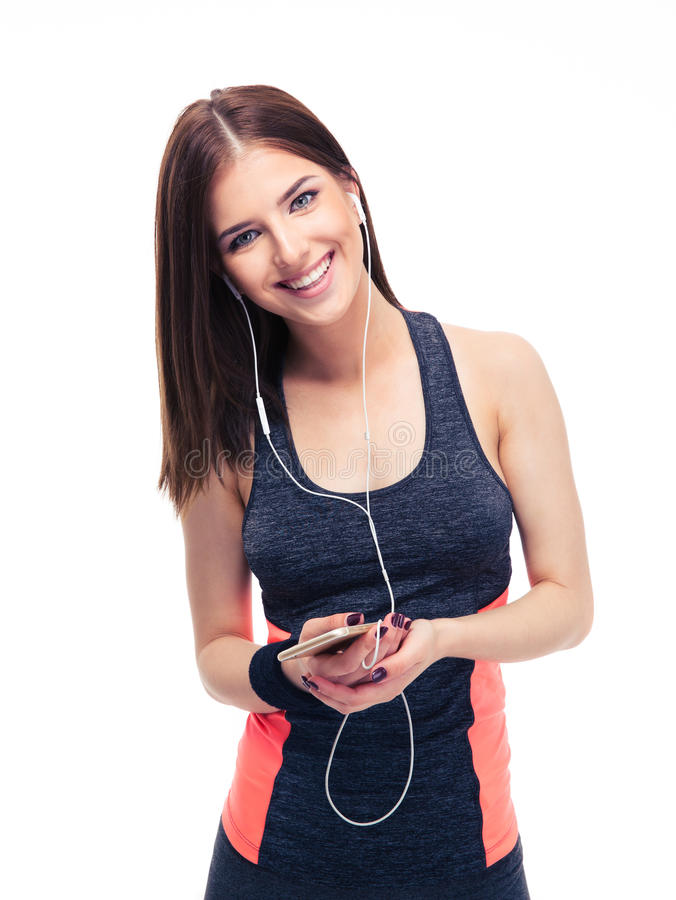 Happy sports woman with smartphone stock photo