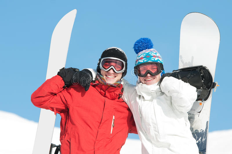 Happy Sportsman With Snowboards Royalty Free Stock Photography