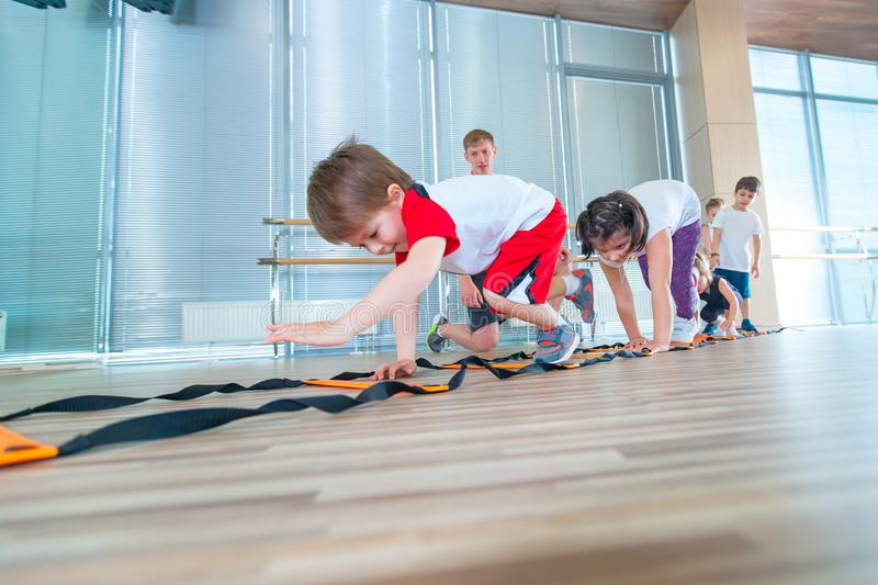 Happy sporty children in gym. Kids exercises royalty free stock image